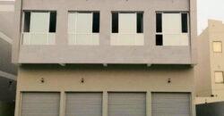 للبيع مبنى تجاري يتكون من 2 دور بمنطقة مدينة عيسى